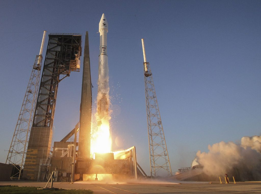 rocket ula osiris rex fairing fuel fire orange launch pad florida blue tower