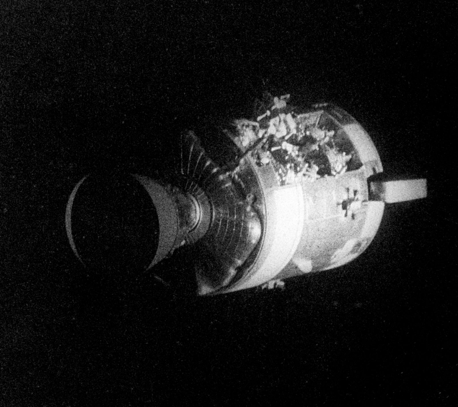 Black and White photo of the Apollo 13 SM with clear damage on one side.