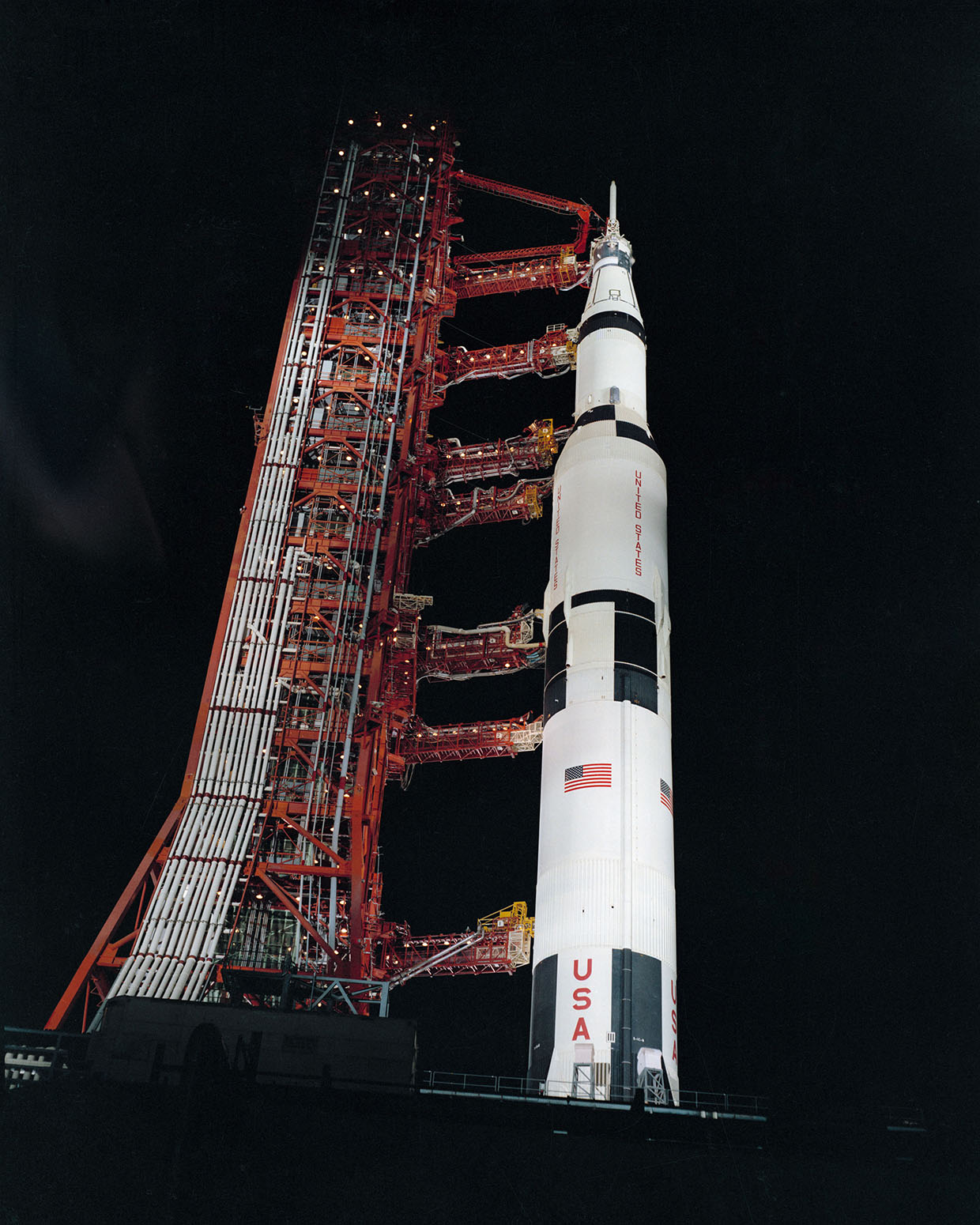 A large Black and White rocket, with a red launch tower, similar Apollo 13