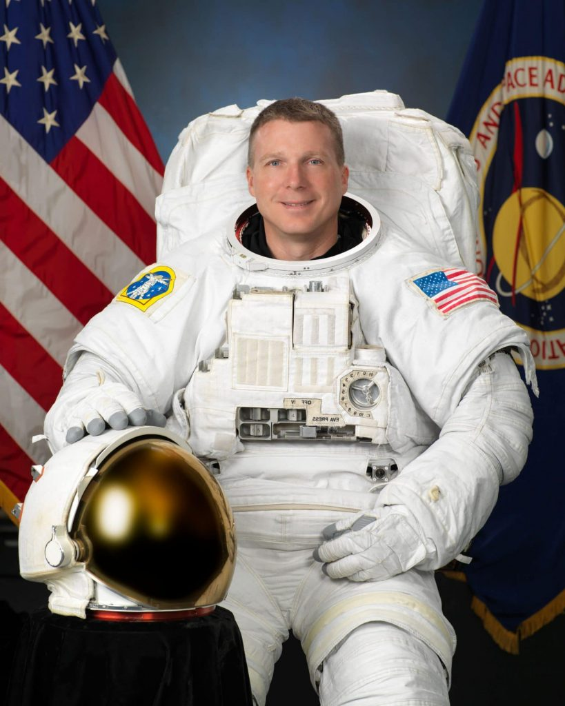 nasa united states flag helmet astronaut terry virts blue red green yellow space suit spacewalk