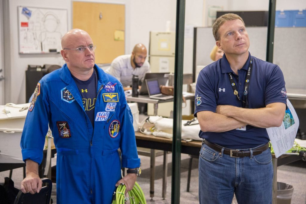 Terry Virts and Scott Kelly standing in a non-descript room during training.