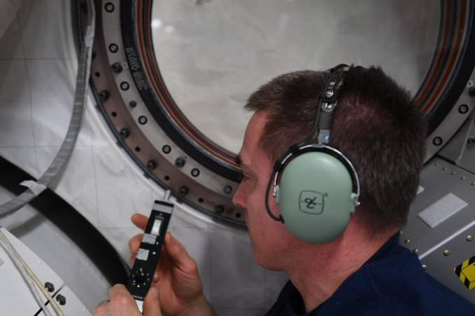Chris Cassidy uses an ultrasound tool to look for the air leak on the ISS