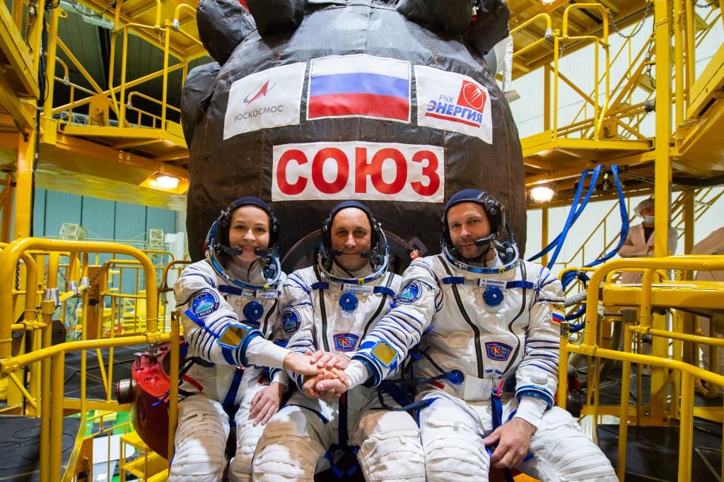 The main crew of the Soyuz MS-19 mission: Yulia Peresild, Anton Shkaplerov, Klim Shipenko wearing Sokol KV-2 suits, Soyuz MS-19