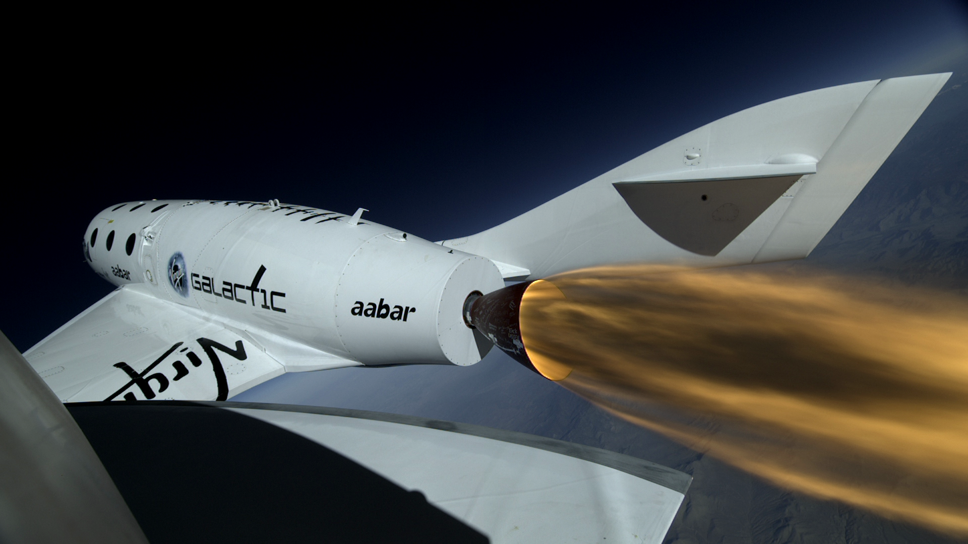 SpaceShipTwo firing its hybrid rocket engine